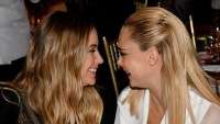 Ashley Benson Stares Lovingly at Cara Delevingne While Sitting During the Trevor Project Gala