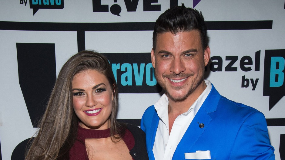 Brittany Cartwright in Maroon Top and Jax Taylor in a Bright Blue Suit Pose Together