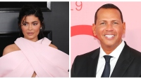 Kylie Jenner in pink criss cross dress Alex Rodriguez in suit