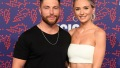 Chris Lane Wears Black Tee And Poses With Lauren Bushnell In White Strapless Top and Skirt at CMT Awards