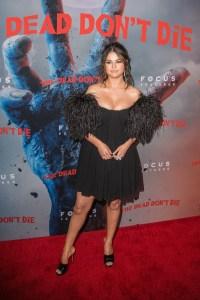 Selena Gomez black feathered dress red carpet dead don't die premiere cleavage boob job