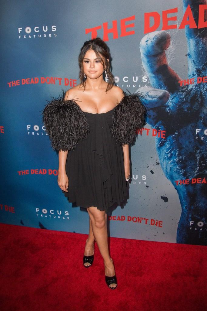 Selena Gomez black dress feathers black heels curly hair dead don't die