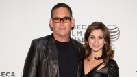 Mike and Laura Fleiss Smile on the Red Carpet