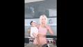 Khloe Kardashian True Thompson good american photo shoot pink sports bra and pants