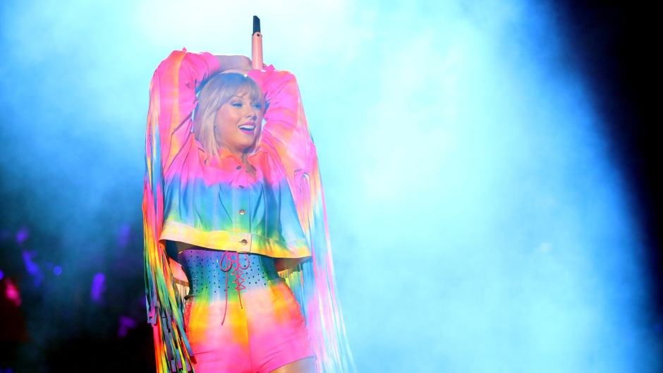 Taylor Swift Wearing Rainbow at a Concert