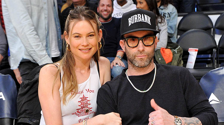 Behati Prinsloo Says She and Husband Adam Levine Can't Agree on How Many Kids They Want
