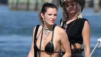 Bella Thorne in a Black Bikini Top and Black Shorts Holding a Drink