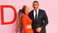 Jennifer Lopez in Orange Two Piece Ballgown Alex Rodriguez in a Suit During CFDA Awards
