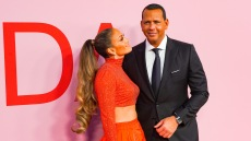 Jennifer Lopez in Orange Two Piece Ballgown Alex Rodriguez in a Suit During CFDA Awards