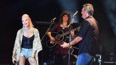 Blake Shelton Wearing a Black Shirt with Gwen Stefani Wearing Jean Shorts on Stage