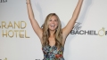 Hannah Brown Grins With her Arms Up on Red Carpet