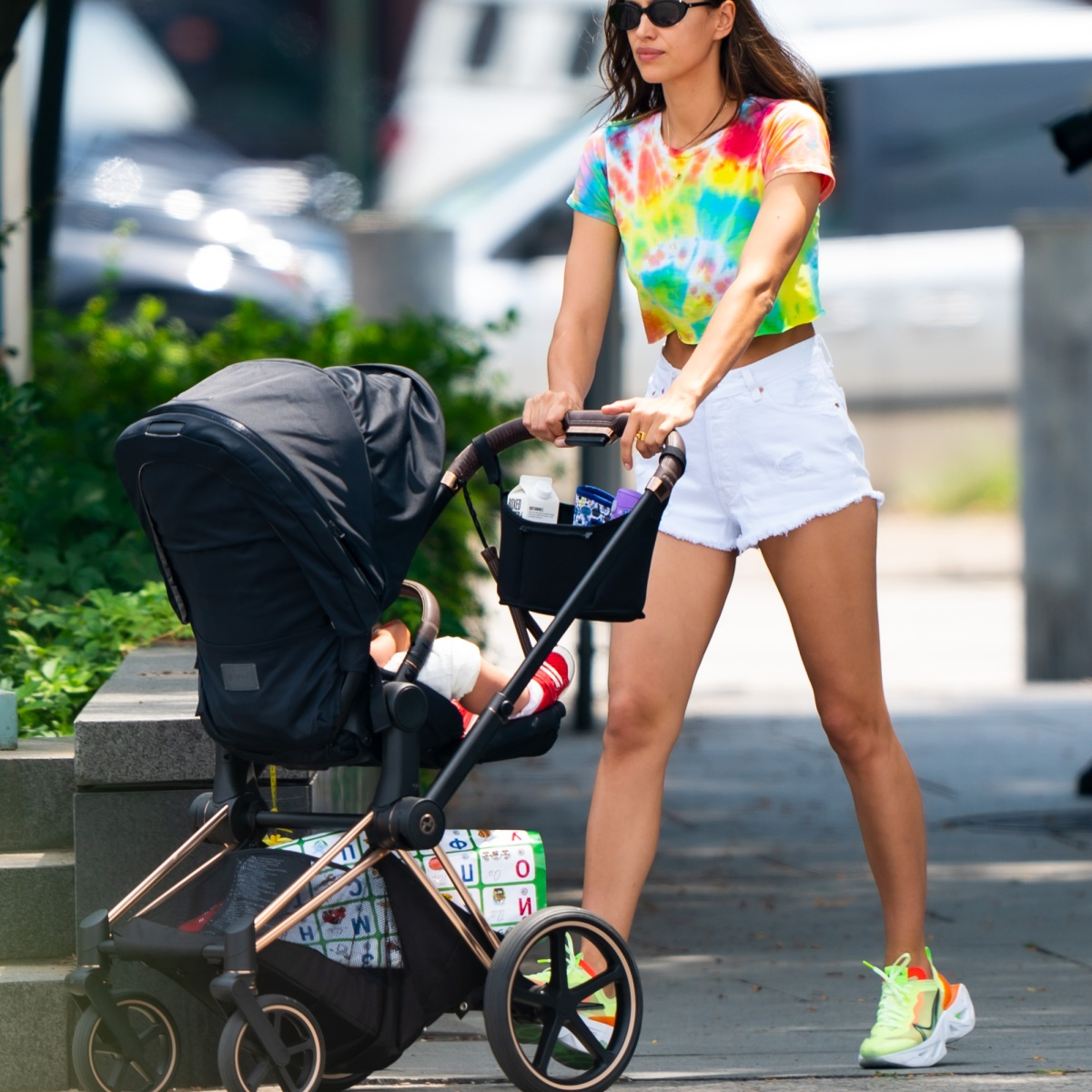 Groovy Mama! Irina Shayk Rocks a Tie-Dye Crop Top and Short-Shorts While Strolling With Daughter Lea