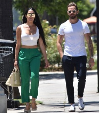 Nikki Bella in Green Track Pants and White Crop Top Running Errands With Artem Chigvintsev in Jeans and White Tshirt