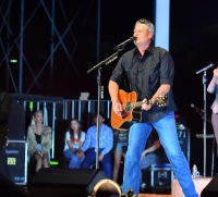 Blake Shelton Performing on Stage With His Guitar