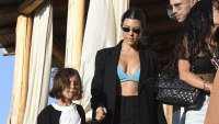 Kourtney Kardashian Out With Penelope Disick in Italy Wearing Green Bra and Black Suit