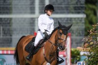 Mary Kate Olsen riding Naomi competes in the Paris Eiffel Jumping