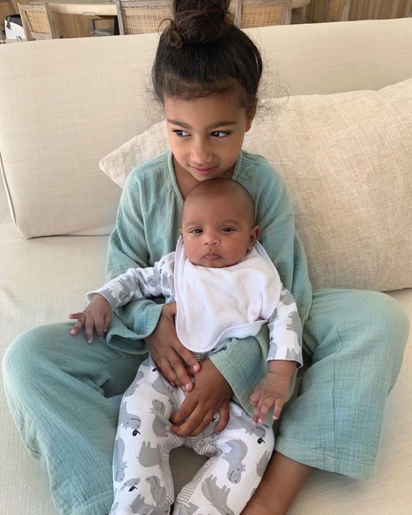 North West Cuddles Baby Brother Psalm While Spurning Saint