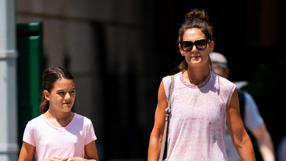 Katie Holmes Wearing Black Leggings With Suri Cruise in Purple Leggings in NYC
