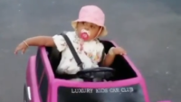 Cardi B's Daughter Kulture in a Pink Jeep