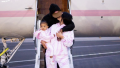 Kylie Jenner Kissing Travis Scott and Holding Stormi Webster