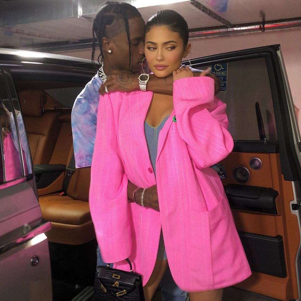 Kylie Jenner Wears Big Hot Pink Blazer While Travis Scott Hugs Her in Blue Tshirt