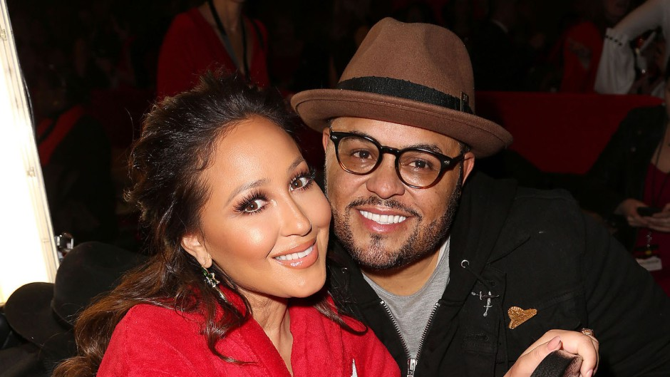 Adrienne Bailon Wearing a Red Outfit With Israel Houghton