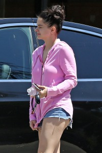 Ariel Winter walking in a pink sweater and denim short shorts