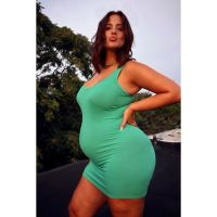 Ashley Graham wearing a mint green dress and making a kissy face