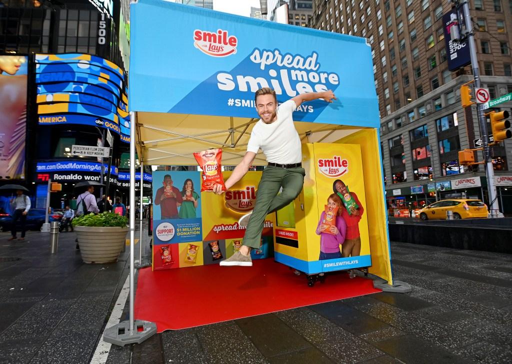Derek Hough on a Lays Truck in NYC