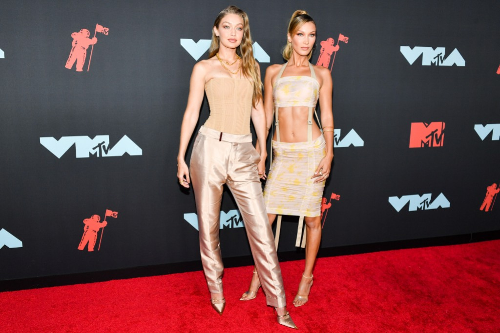 Gigi Wears Beige Corset and Pants While Bella Hadid Wears Beige Crop Top and Skirt at MTV VMAs Red Carpet