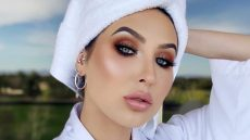 Jaclyn Hill taking a selfie wearing a bathrobe and towel on her head