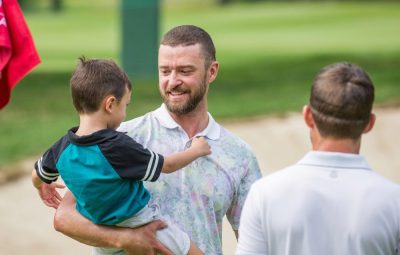 justin timberlake holds silas on golf course