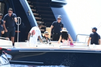 Kylie Jenner Wearing a Hat and Dress on a Boat in Italy