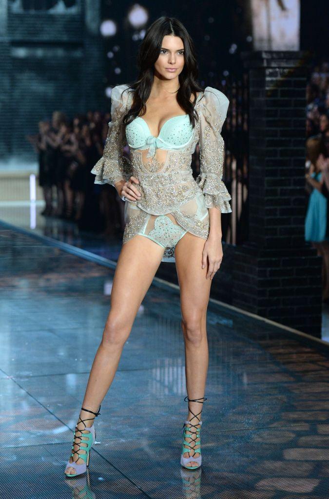 Kendall Jenner walking down the runway in 2015 wearing blue lingerie