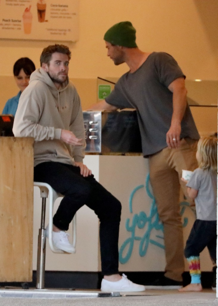 Liam Hemsworth Sitting on A Stool at a Cafe in Australia