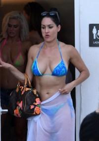 Nikki Bella wears a blue bikini by the pool as she films Total Divas in Miami Beach