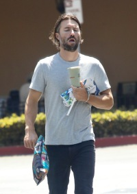 Brandon Jenner out running errands blue shirt and jeans with pregnant Cayley Stoker