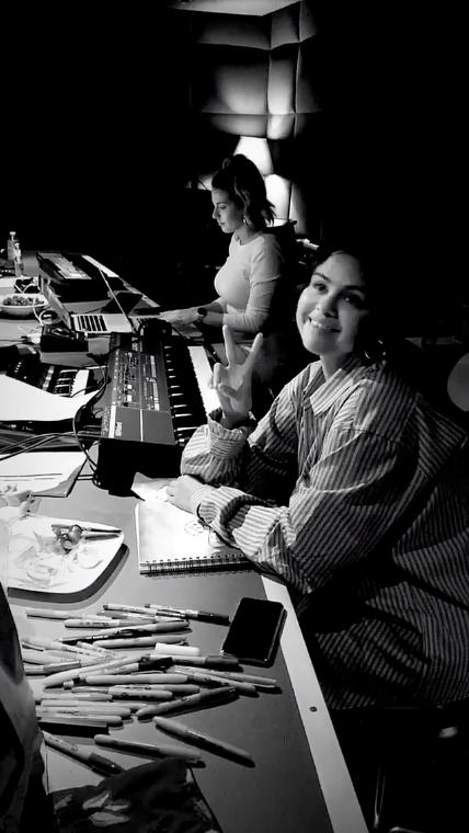Selena Gomez looks happy in the studio working on her new album
