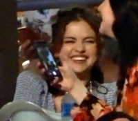 Selena Gomez smiling at a Kacey Musgraves concert