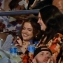Selena Gomez smiling at a Kacey Musgraves concert