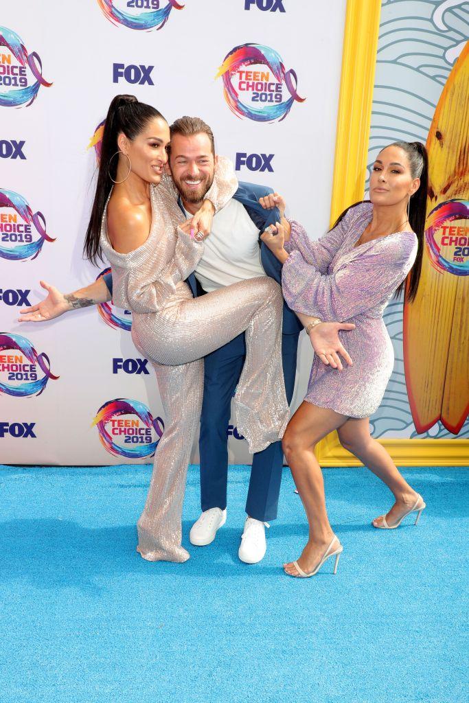 Nikki Bella, Brie Bella and Artem Chigvintsev