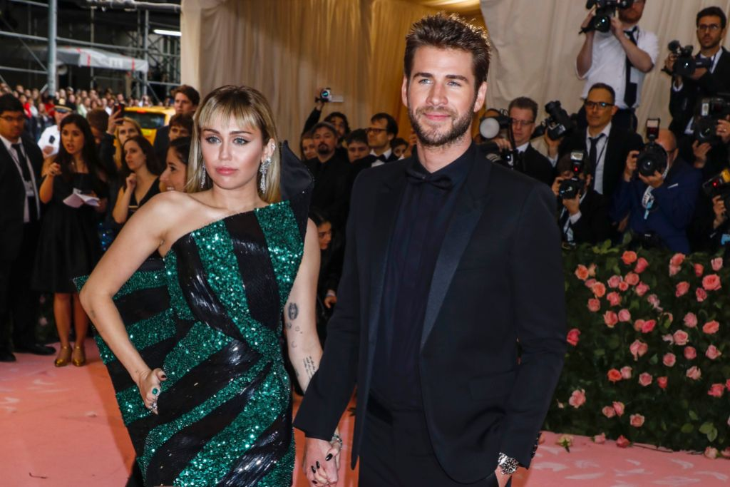 Miley Cyrus and Liam Hemsworth Smile and Hold Hands at the Met Gala