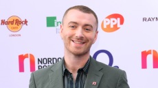 Sam Smith Smiling in a Green Suit Heartfelt Instagram Message I am Enough