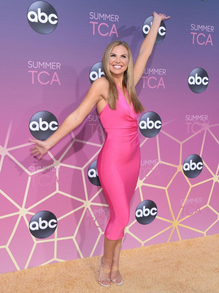 Hannah Brown Pink Dress Posing With Arms Up