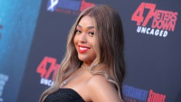 Jordyn Woods Close Up on 47 Meters Down Red Carpet Red Lipstick and Black Dress