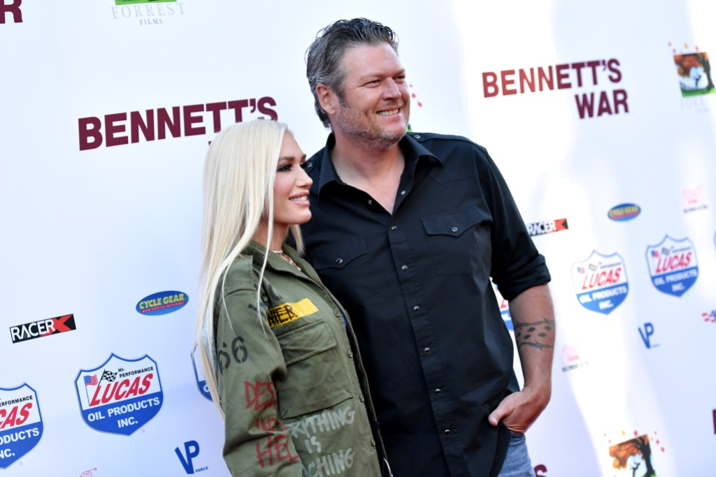 Gwen Stefani in a Green Military Jacket Stands With Blake Shelton in a Black Button Down on Bennetts War Red Carpet