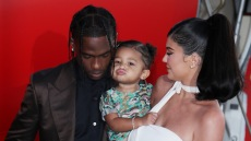 Travis Scott and Kylie Jenner Laugh at Stormi Webster on the red carpet for Look Mom I Can Fly