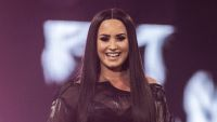 Demi Lovato Long Black Straight Hair and Black Costume on Stage Birthday Message