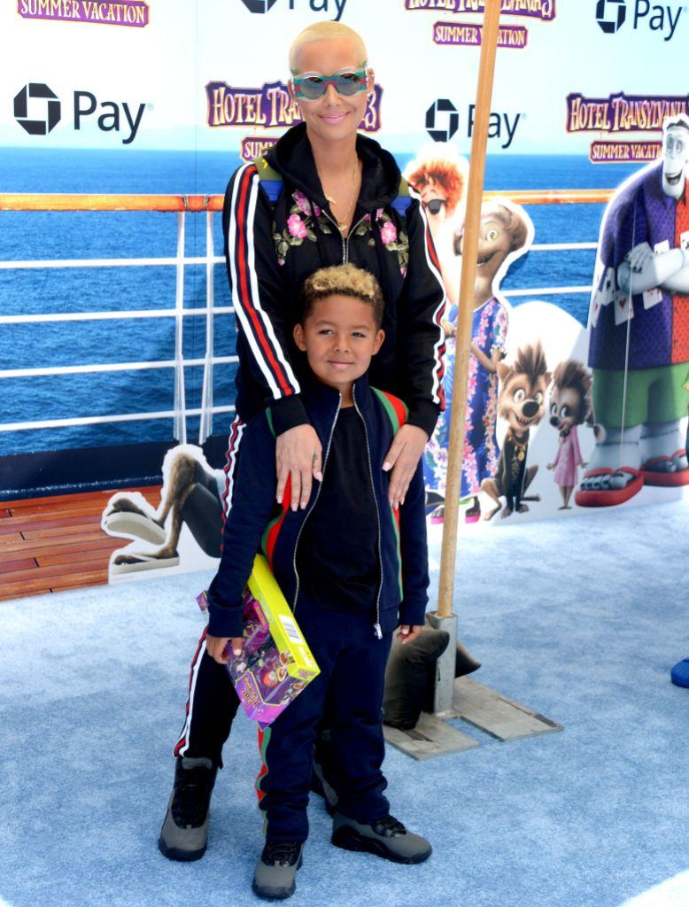 Amber Rose posing with her son, Sebastian Taylor Thomaz