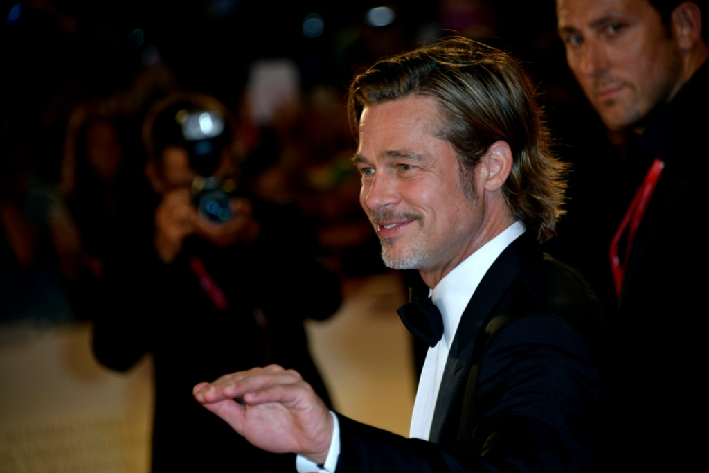 Brad Pitt Wearing a Suit and Smiling